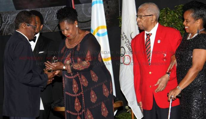 Veteran journalist Dave Lamy (left) receives the Alexander Chapman Award from President Paula-Mae Weekes, at the TTOC Awards, Hyatt, Port of Spain on December 29 2018. Behind them is TTOC president Brian Lewis. Also in photo is Alexander Chapman (second from right) and TTOC Secretary General, Annette Knott. PHOTO BY ANGELO MARCELLE. - Angelo Marcelle