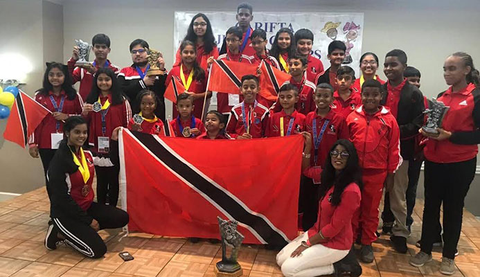 TT's chess team display their medals and trophies after competing at the Carifta Chess Championships, in Curacoa, on the Easter weekend.