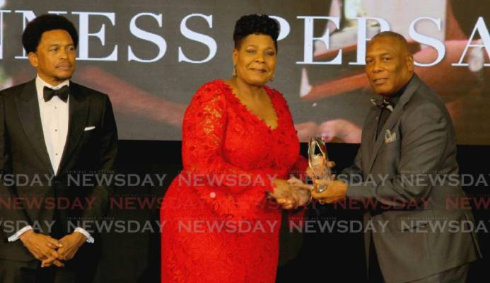 President Paula-Mae Weekes (centre) presents the Alexander B Chapman Award to NAAA president Ephraim Serrette (right), on behalf of veteran track and field coach Gunness Persad, at the TTOC award ceremony, at the Hyatt Regency Hotel, Port of Spain on Sunday. Also in photo is TTOC president Brian Lewis. PHOTO BY ROGER JACOB. - ROGER JACOB