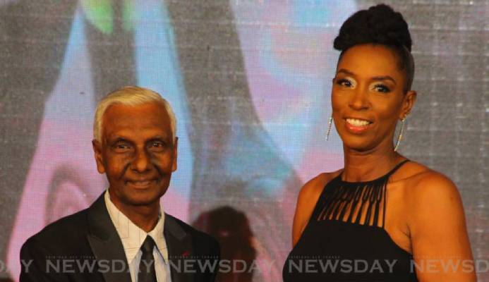 TT Olympic Committee's Dr Terry Ali (L) presents the Sportswoman of the Year award to Euphemia Huggins, who collected the award on behalf of her daughter and TT cyclist Teniel Campbell, at the TTOC's awards ceremony, at the Hyatt Regency, Port of Spain,on Sunday. - ROGER JACOB
