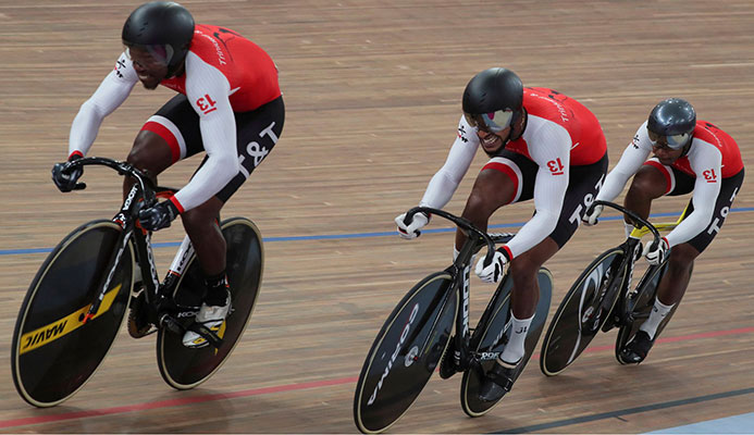 FLASHBACK: Trinidad and Tobago cyclists, left to right, Nicholas Paul, Njisane Phillip and Keron Bramble during their Men's Team Sprint gold medal effort at the 2019 Pan American Games in Lima, Peru, last August 1. Team TTO were stripped of that medal and also a silver in the Men's Individual Sprint, due to a positive drugs test, which is under appeal by one of the athletes. —Photo: AFP