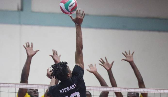 Triple T La Cura Sport's Daynte Stewart stretches to connect with a spike as the Technocrats' trio of Ryan Stewart, Newton Grant and Adriel Richards go up to block in their Men's Division 2019 Office of the Prime Minister Premier Volleyball League match at the Central Regional Indoor Sports Arena, Chaguanas on Tuesday night. La Cura Sport won 25-16, 25-23, 20-25, 22-25, 15-10.  T&TVF