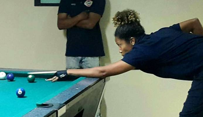 "Upper Deck's Priya Gomes who defeated Sunil ""Elvis"" Roopnarine 3-1 to help her team beat Fearless in Round 17 of the Billiards Sports Organisation's National Pool League 10-Ball competition on Wednesday evening at the Dekko Sports Bar in Princes Town."
