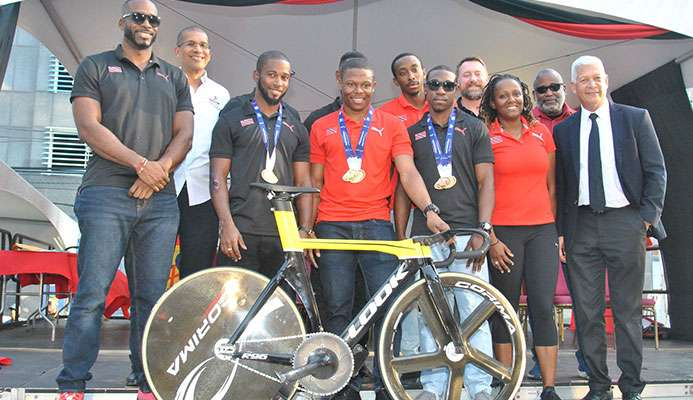 CELEBRATION TIME! Cyclist Nicholas Paul, the fastest man in the world, is surrounded by his national teammates Quincy Alexander, left, Kwesi Browne, 2nd from left, Port-of-Spain Mayor Joel Martinez, right, Antonia Berton, 2nd from right, and Keron Bramble. The team won a gold medal in the team sprint event, while Paul set a new world record in the flying 200meters event at the just concluded Elite Pan American Continental Championship in Bolivia and was celebrated on the Brian Lara Promenade in the Capital City on Saturday.